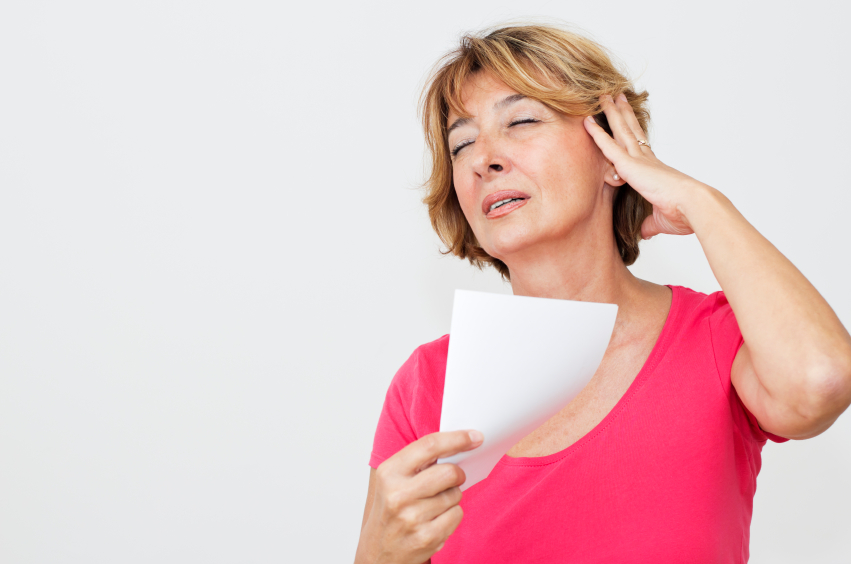 Woman in Menopause suffering hot flushes